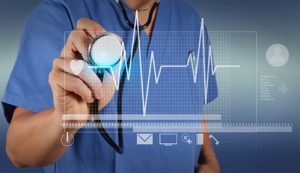 A medical professional holding a stethescope and checking the digital medical reports.